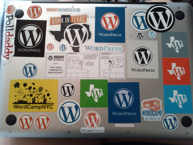 Fellow Automattician Sara Rossos laptop, covered in WordPress stickers. Image Source