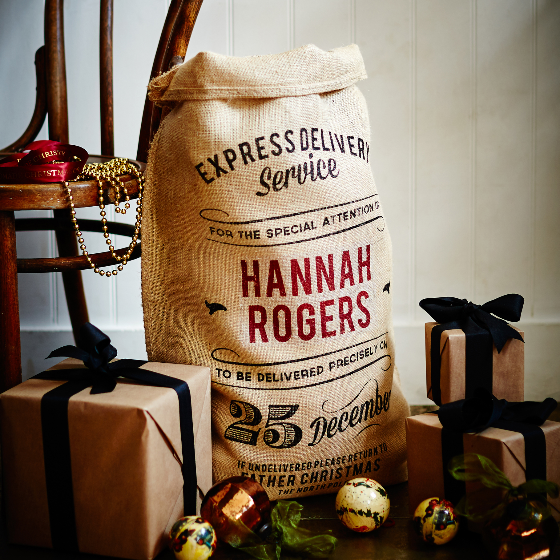 Order a personalized sack of your choice, fill it with gifts, and keep those curious hands at bay until the time is right. (That's the hard part, we think.)