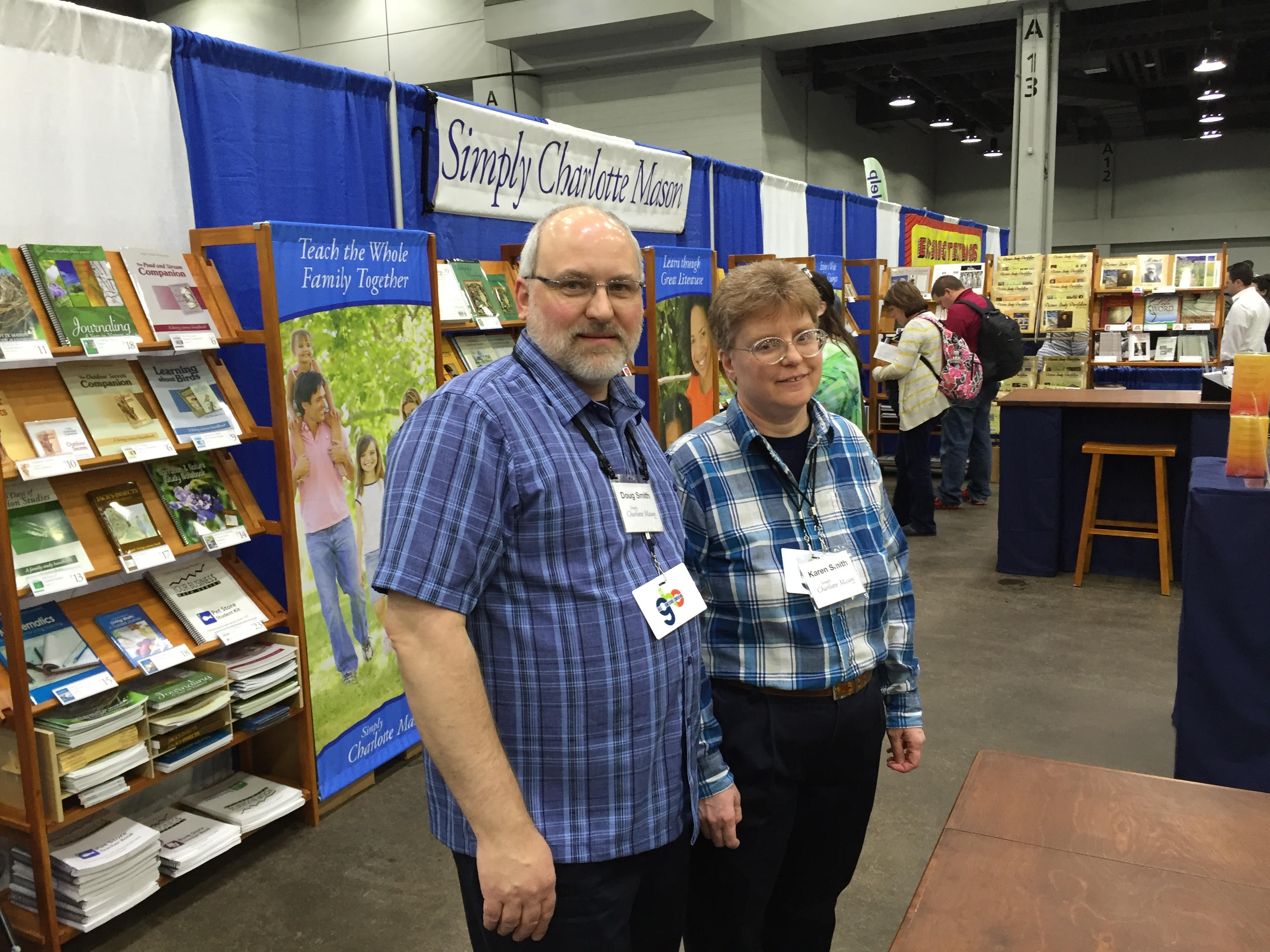A photo of Doug and his wife, Karen, in their booth at a homeschool convention.