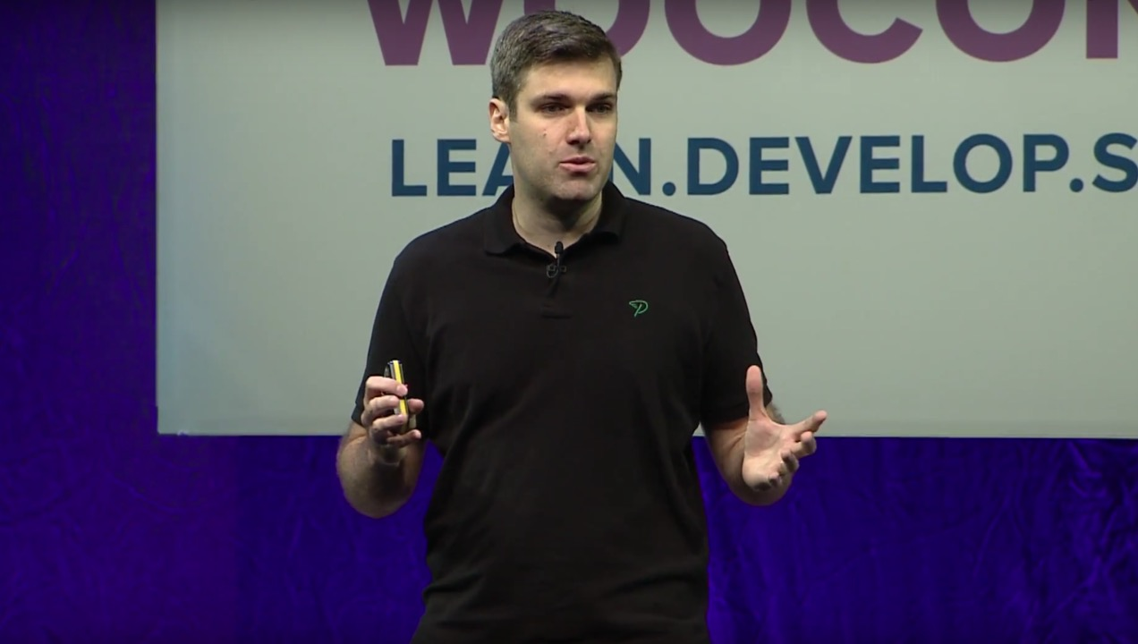 Brent Shepherd on stage at WooConf 2016.