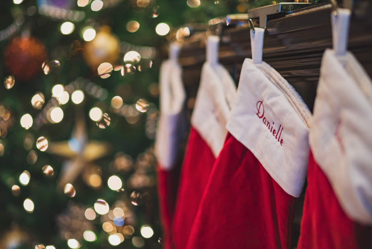 stockings hanging on a mantle by the Christmas tree