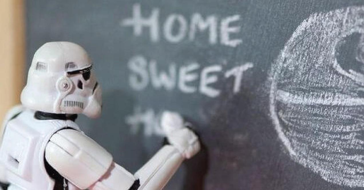 Star Wars storm trooper figurine writing on a chalkboard.