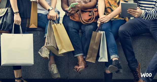 customers with shopping bags and shopping online using mobile devices