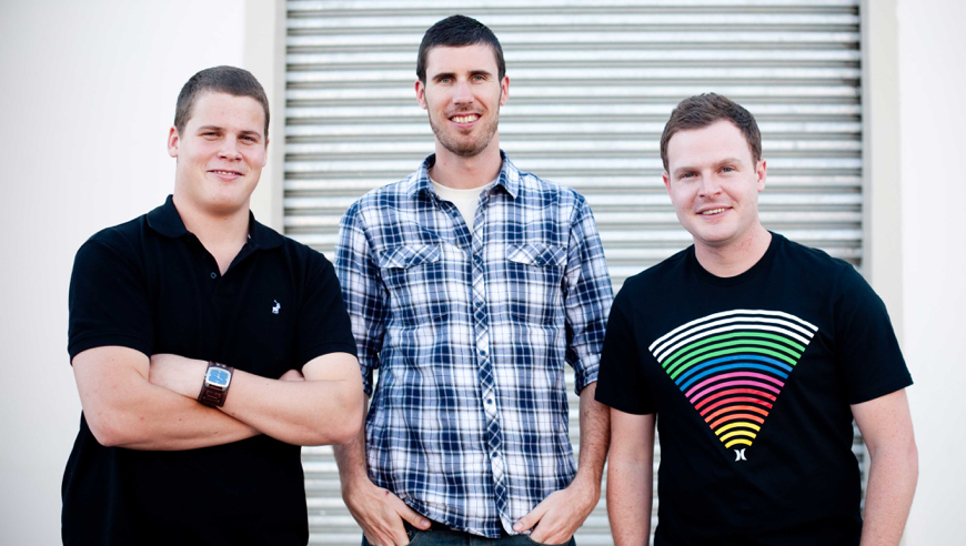 A photograph of WooThemes co-founders Adii, Magnus, and Mark.