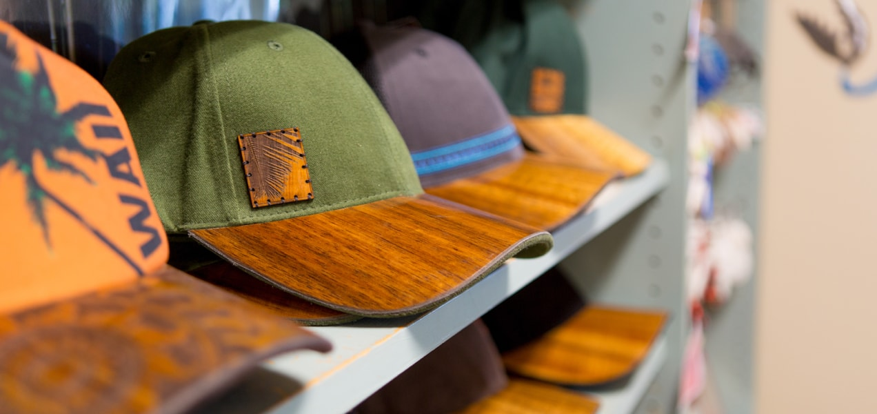hats with wood brims on a shelf