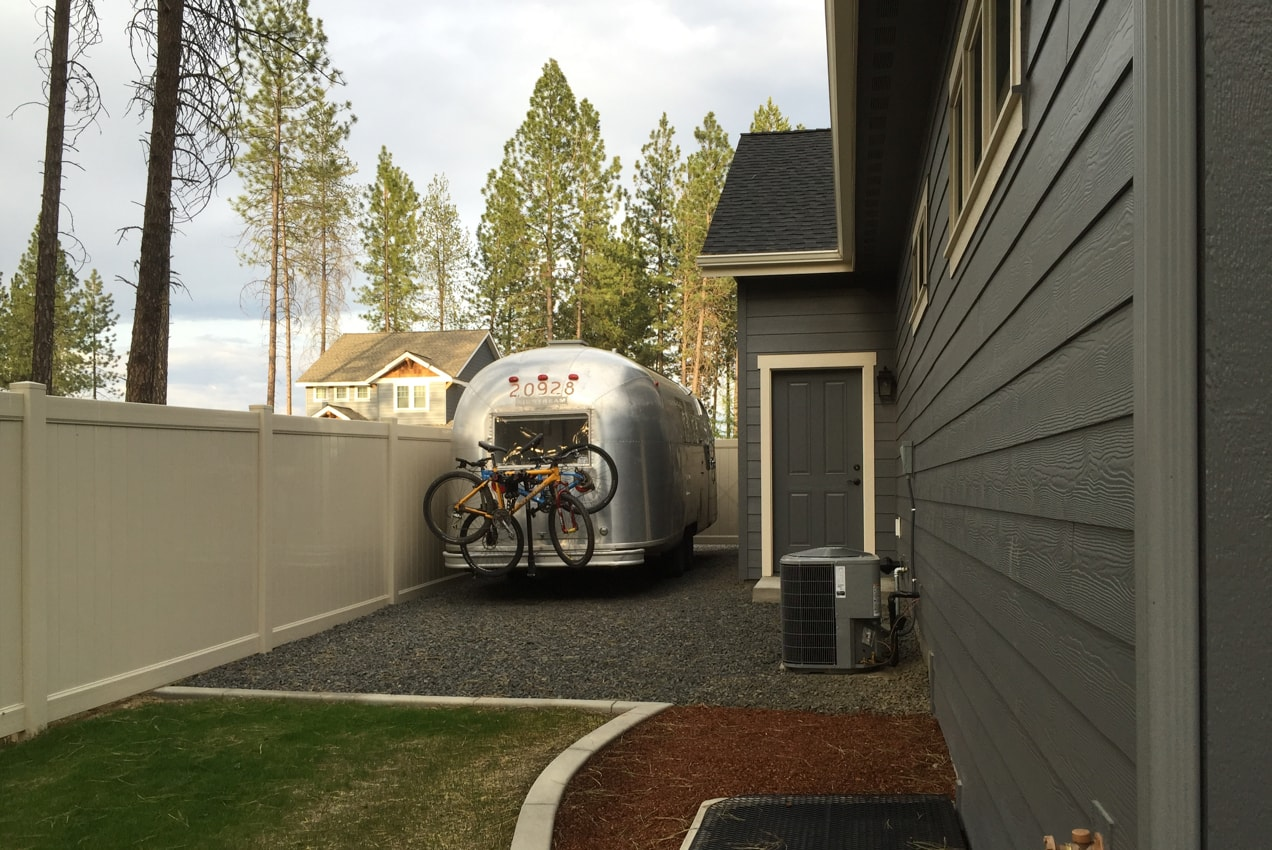 Airstream trailer parked next to a friends' house