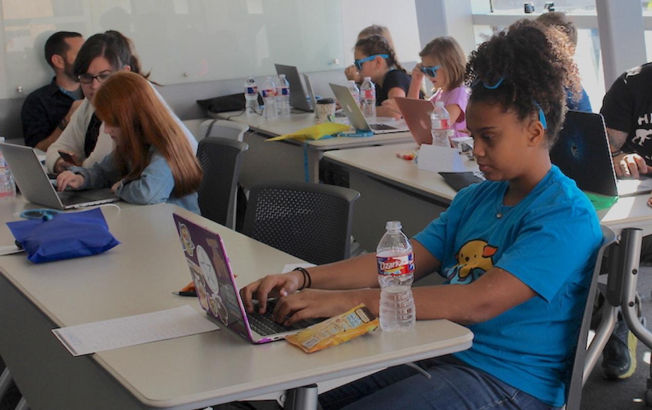 Annika working on her website at KidsCamp
