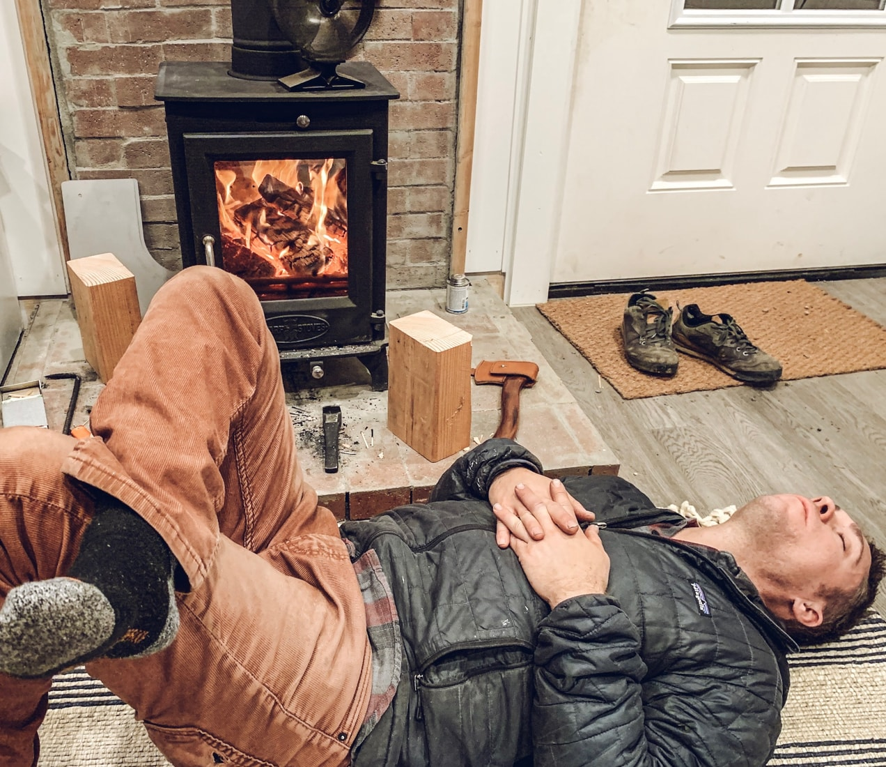 Taking a nap in front of a tiny wood stove