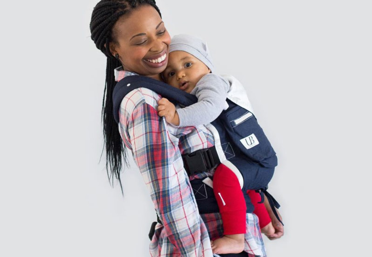 woman carrying her baby in a carrier