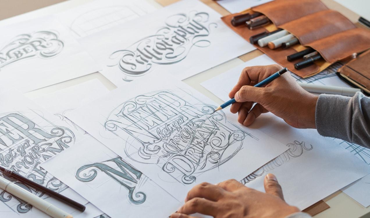 artist illustrating t-shirt designs