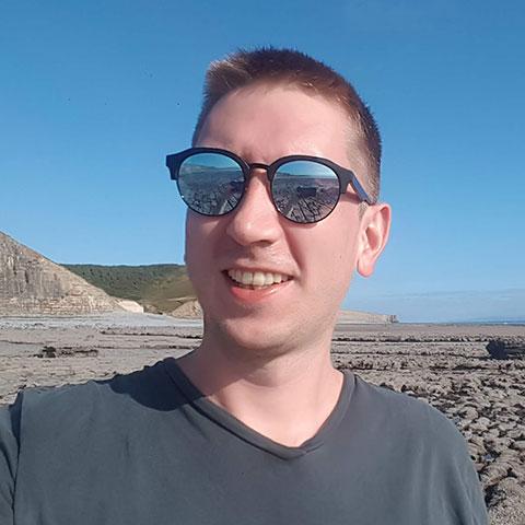 Photo of Oli, developer who uses WooCommerce backup by Jetpack