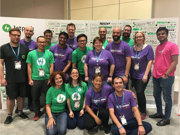 WooCommerce and Jetpack teams posing at an event booth