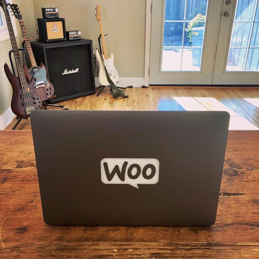 Custom laptop with a WooCommerce logo engraving