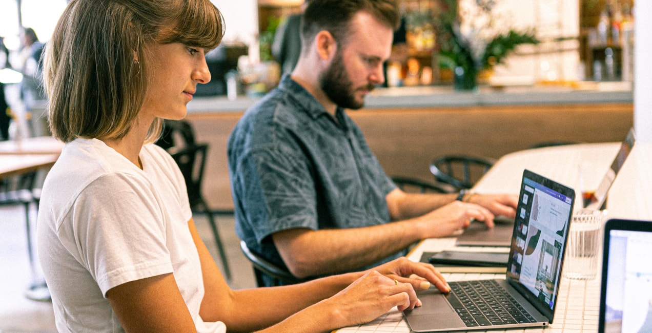 entrepreneurs looking at brand guidelines on a computer