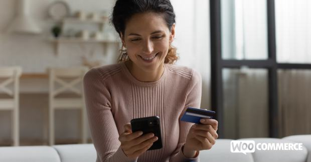 customer checking out on a mobile device with a credit card
